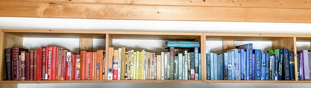 Commit's CXO, Noel Pullen, has his colour-coded bookcase on display in the back of all his zoom calls.